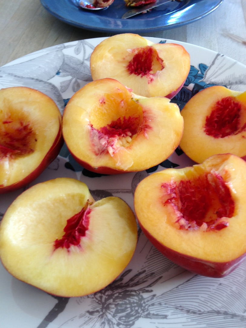 Peaches halved & pitted
